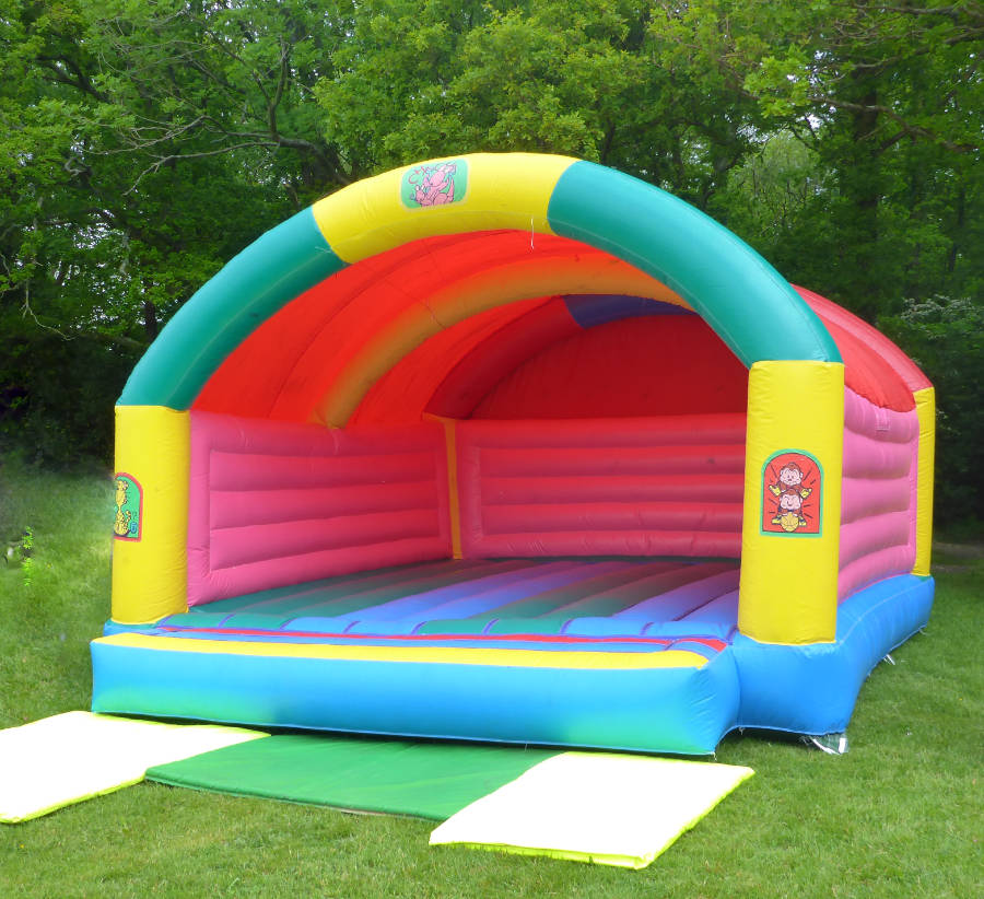 Covered Bouncy castle with a beach print theme